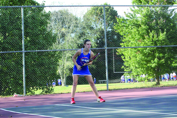 """Above, Savannah Smith awaits to return the ball after her opponent serves. """"I was very focused on getting the ball back over the net,"""" Smith said."""