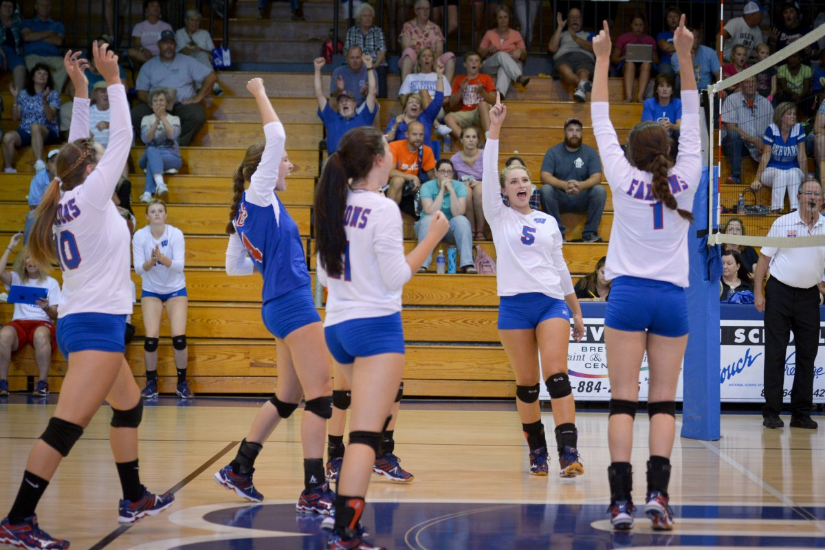 The volleyball team rejoices after a 3-0 win over Brevard. The Lady Falcons will travel to the NCHSAA 3A state finals at North Carolina State University to play against Cardinal Gibbons on Saturday.