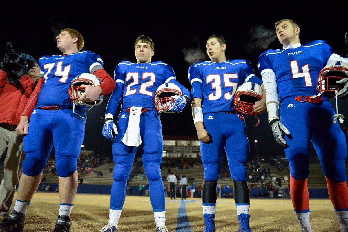 Football team captains senior Brian Albea, junior Stephen Perron and seniors Brendan Goings and Cody Jackson take the field for the coin toss at the beginning of last nights home playoff game against Kings Mountain. The Falcons went on to win the game against Kings Mountain 41-27 and earned a second round home playoff game against East Rowan. Photo by Ralph Raesemann.